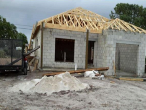 House made of cinderblocks and wood beams for roof under construction in south Florida