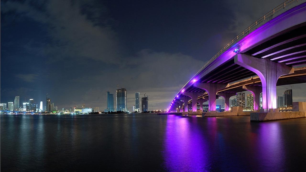 Picture of Miami bridge with purple spotlights