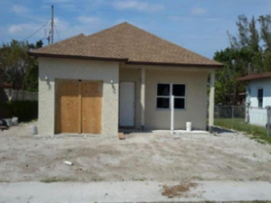 Tan house with brown roof under construction in south Florida